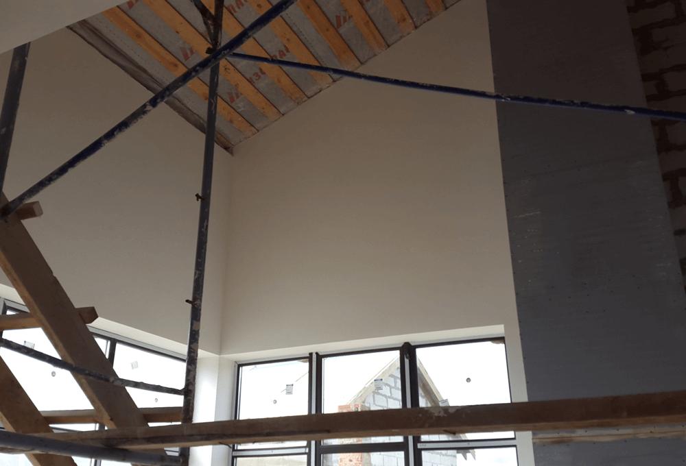 Штукатурка стен в коттедже